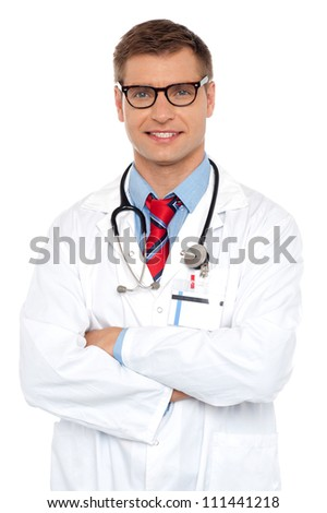 Attractive portrait of confident male doctor posing with arms crossed