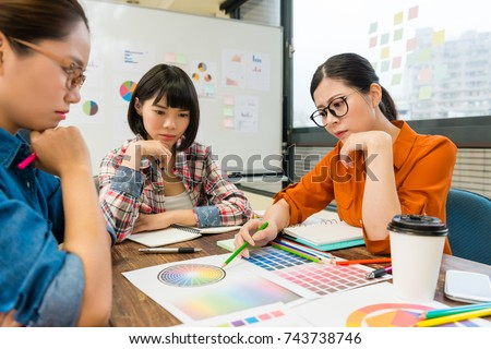 attractive pretty design company female office worker having problem feeling confused when they meeting together and thinking new product main color.