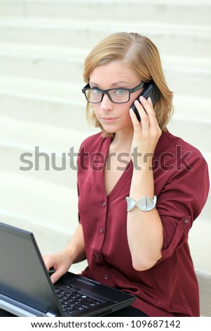 Attractive Professional Business Woman Frustrated, On the Phone and computer, and Looking to the Camera