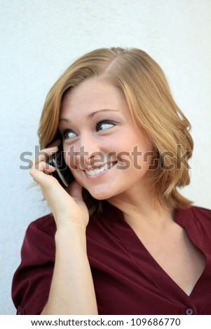 Attractive Professional Business Woman Smiling and On the Phone While Looking to the Side