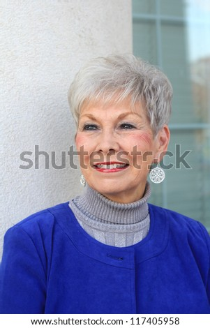 Attractive, Retired Mature Professional Business Woman Smiling