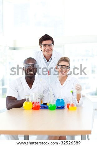 Attractive Science students examining test-tubes in university