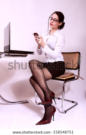 attractive secretary with eyeglasses. office background