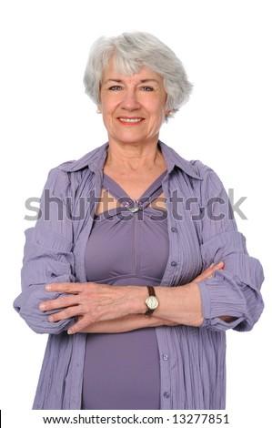 Attractive senior citizen woman in exercise clothes - stock photo