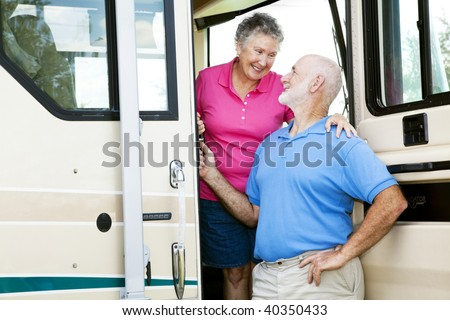 Attractive senior couple traveling by motor home.