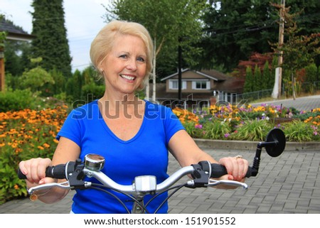 Attractive senior lady on a bicycle.