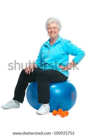 Attractive senior woman at health club, doing exercises