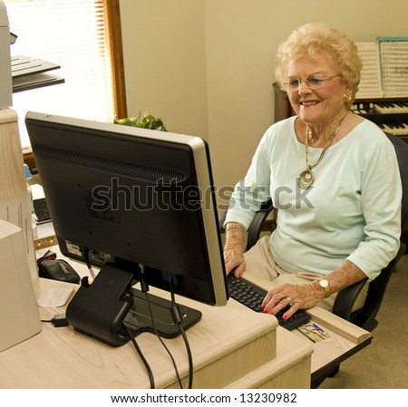 Attractive senior working at her PC
