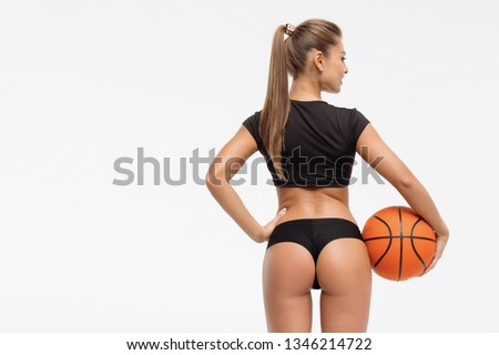 Attractive sensual woman in lingerie holding ball