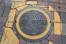 attractive sewer or manhole cover on street in Seoul, South Korea