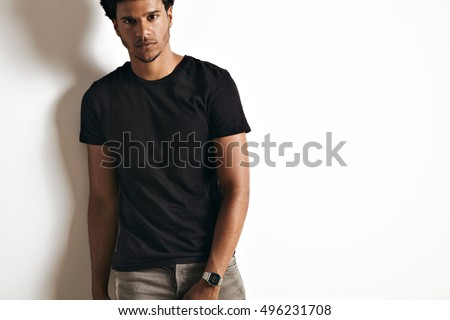 Attractive sexy African American young man wearing a blank cotton black t-shirt isolated on white #496231708