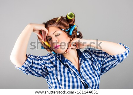 attractive sexy housewife with curlers