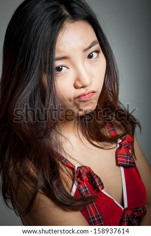 Attractive sexy santa claus asian girl in her 20s isolated on a grey  background #158937614