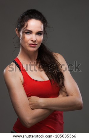 Attractive sexy young woman having a rest during her exercise