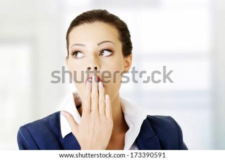 Attractive shocked businesswoman