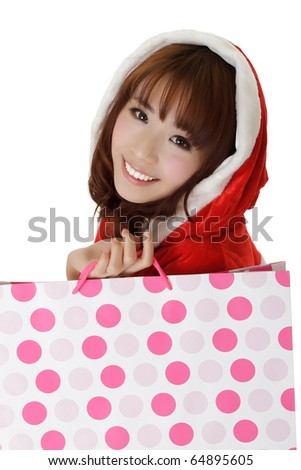 Attractive shopping girl in Christmas clothes showing smiling face.