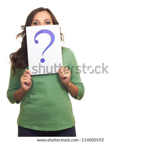 Attractive smiling girl in a green shirt and holding a a sheet of paper with a big question mark, and covers her face. Isolated on white background