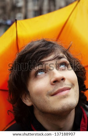 Attractive Smiling Man with Umbrella Checking Sky After Rain