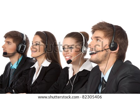 Attractive Smiling positive young businesspeople and colleagues in a call center office, support phone operators with headset at workplace isolated over white background, agent friendly looking