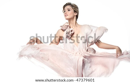 attractive smiling woman in pink dress on white background