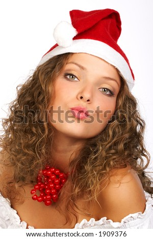 Attractive smiling woman in Santa Cap blowing kisses