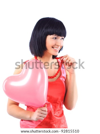 attractive smiling woman isolated on white with heart balloon