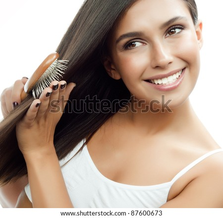 Attractive smiling woman with heart on white background stock photo