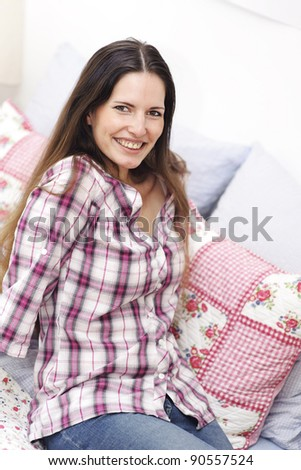 Attractive smiling woman relaxing