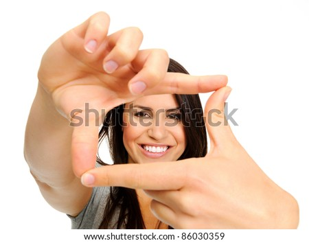 Attractive smiling woman using her hands to create a border around her face