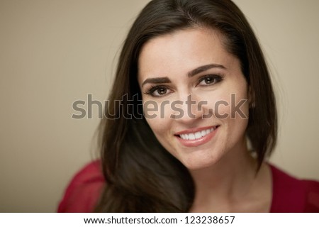 Attractive smiling young woman closeup portrait