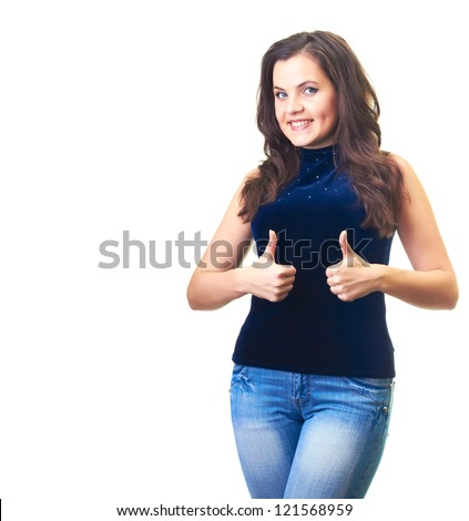 Attractive smiling young woman in a blue shirt and blue jeans shows her finger up with both hands. Isolated on white background