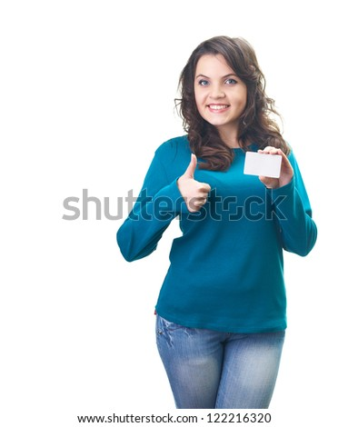 Attractive smiling young woman in a blue shirt holding a poster in her left hand and her right hand showing thumbs up. Isolated on white background