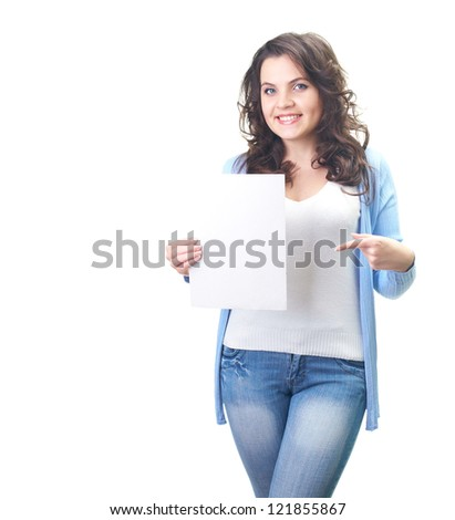 Attractive smiling young woman in a blue shirt holding in her right hand, a poster, and her left hand points to him. Isolated on white background