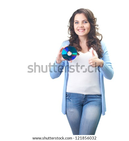 Attractive smiling young woman in a blue shirt holding in her right hand disk and her left hand showing thumbs up. Isolated on white background