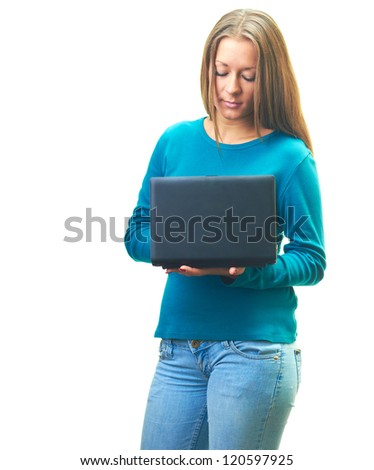 Attractive smiling young woman in a blue shirt holding laptop in her hands and looking at the laptop screen. Isolated on white background