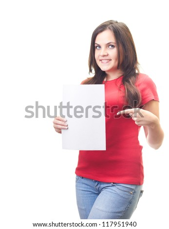 Attractive smiling young woman in a red shirt holds in her right hand, a poster, and the left hand points to the poster. Isolated on white background - stock photo