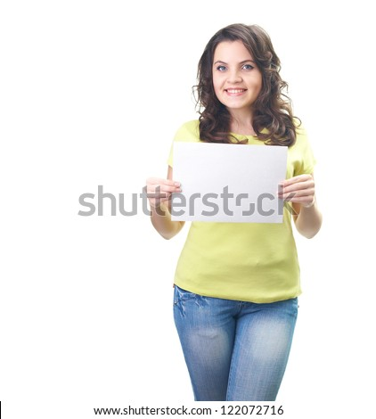 Attractive smiling young woman in a yellow shirt holding a poster. Isolated on white background