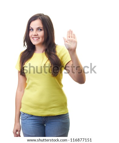 Attractive smiling young woman in a yellow shirt shows her left hand sign hello. Isolated on white background
