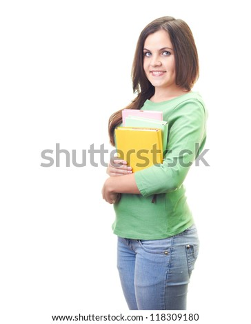 Attractive smiling young woman in green shirt holding a colorful book. Isolated on white background