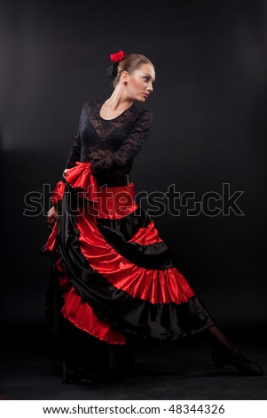 Attractive spanish dancer over black background