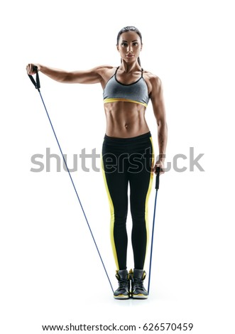 Attractive sportswoman performs exercises with resistance band. Photo of woman with a sports figure isolated on white background. Strength and motivation
