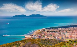 Attractive spring cityscape of Vlore city from Kanines fortress. Captivating morning sescape of Adriatic sea. Spectacular outdoor scene of Albania, Europe. Traveling concept background.
