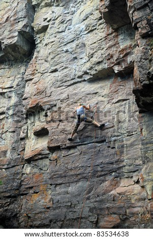 Attractive, strong and fit female rock climbing in Banff National Park near Lake Louise in Canada