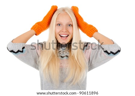 attractive surprised excited smile woman looking at camera holding hands on head, wear winter knitted sweater and orange gloves, isolated over white background