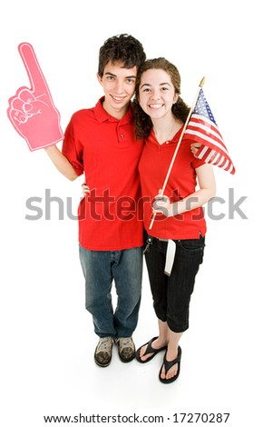 Attractive teen couple supporting their favorite sports team or political party.  Full body isolated on white.