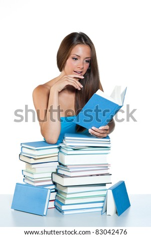 attractive teen girl reading book and learning