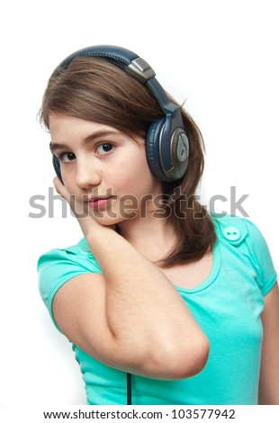 attractive teen girl with headphones on white background .image of beautiful girl listening to music