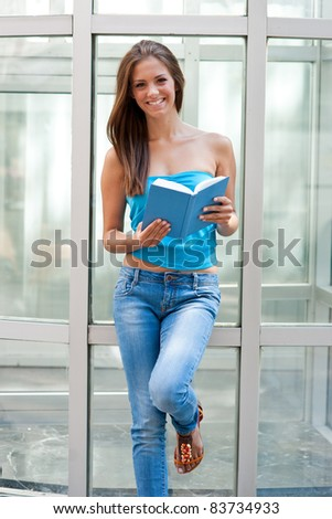 attractive teen girl with school books outside