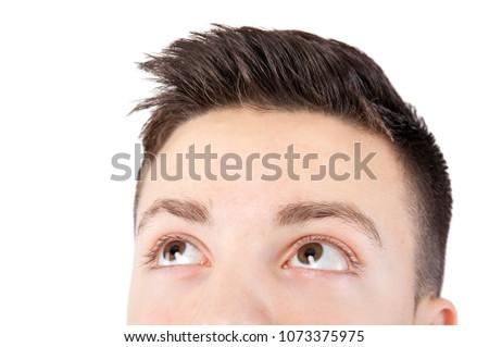 attractive teenage boy face looking up #1073375975