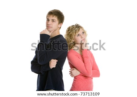 Attractive teenage couple standing back to back thinking in studio with white background